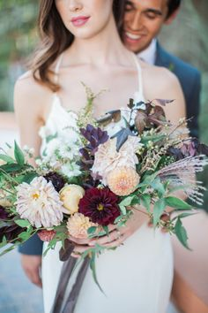 Dahlia, ranunculus and rose wedding bouquet: http://www.stylemepretty.com/2016/11/23/autumn-photo-shoot/ Photography: Natalie Bray - http://nataliebray.com/