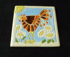 SOLD!!!   Happy little Hen -- embossed 'by hand' before firing to bisque.