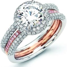 LOVE THIS SOOO MUCH! Engagement ring with a pink wedding band that fits in the middle. completely perfect.