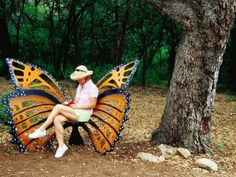 Woman sitting in a butterfly chair at botanical gardens Zilker Park, Austin, TX. Photographer Richard Cummins (no idea who the artist who created the butterfly chair was)