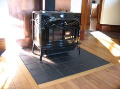 Hearth Inlay - traditional - living room - burlington - by New Frameworks Natural Building Wood Stove Surround, Wood Stove Hearth, Hearth Tiles, Brick Fireplace Makeover, Stove Fireplace, Fireplace Hearth, Fireplace Ideas, Soapstone Stove, Corner Wood Stove