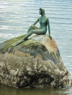 Girl on a Rock by Gord Bell, via Flickr. Swimmer resting on a rock statue in Stanley Park, Vancouver, BC, Canada.