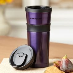 A really good travel mug that keeps my coffee hot for a LONG time (BONUS: This one is PURPLE!!!)