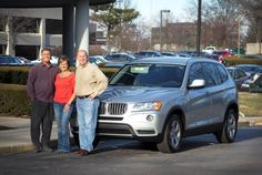 Executive Sales Managers Kim and Jerry Glenn of Knoxville, TN stand outside the #FHTM Headquarters in Lexington, KY with President and Founder Paul Orberson and their new #BMW!