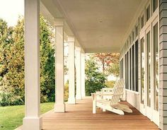 front porch, wrap around to side and back.  Extend it out another 3-4 feet.  Just like this, one step up, no railings, square columns with big sliding doors and large windows.
