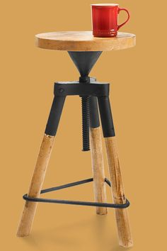 This three-legged iron and recycled-wood piece spins to your desired height, making for an excellent end table. From totallyfurniture.com