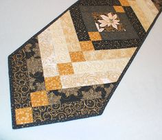 Elegant Quilted Table Runner  Black and Gold by QuiltSewPieceful