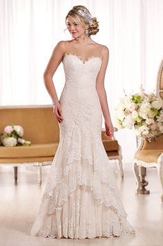 Beautiful lace wedding dress with an illusion neckline. Essense of Australia, Fall 2015