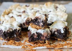 These S'mores Brownies are super fudgy chocolate brownies swirled with marshmallow fluff and milk chocolate chips, baked on a graham cracker crust and topped with toasted mini marshmallows.