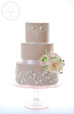Vintage inspired wedding cake with delicate piping and sugar flowers.