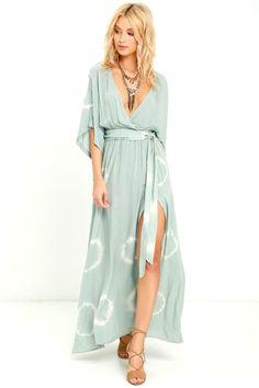 Sunshine can't help but follow you in the Long Live Love Sage Green Tie-Dye Maxi Dress! Tie-dyed maxi dress with wide sleeves and surplice bodice.