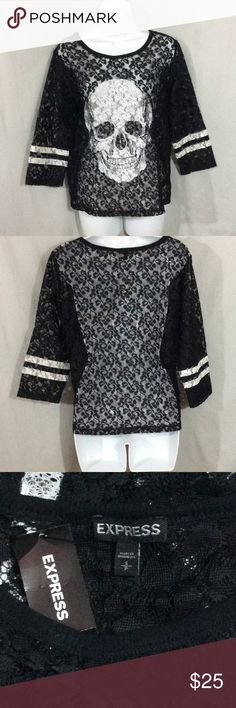 NWT Express Black/ White Lace Skull Top NWT Express Lacy See Thru Black/White Skull Top 100% Polyester. 3/4 Sleeves, 2 white-bands around the bottom of each sleeve. Measurements Listed Below in Comments Express Tops