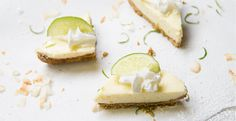 A pistachio and coconut graham crust compliments the tangy key lime bar filling. Try garnishing this tart treat with coconut whipped cream and a slice of lime. #desserts #recipes #foodies #lime #coconut