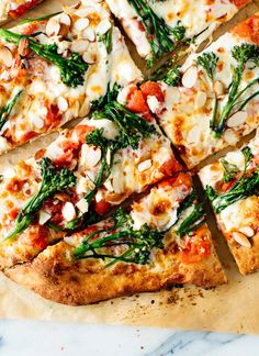 Homemade broccolini pizza with almonds (optional), mozzarella and red sauce! The trick to making awesome broccolini pizza is to blanch the broccolini first.