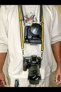 Two camera strap. Holds two cameras plus accessories at the same time. Made with your color choice and your exact measurements. Go to HandsomeWarrior on etsy and ask about getting one made for you. Paracord Camera Strap, Camera Straps, Cameras, Grid, Macrame, Knot, Bags, Accessories, Etsy