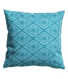 Turquoise. Cushion cover in slub-weave cotton fabric with a printed pattern. Concealed zip.