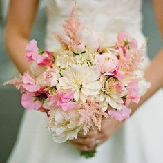 Pale Pink Bouquet | Light pink astilbe adds soft, fuzzy texture to this bride's arrangement, which also consists of peonies, hydrangeas, dahlias, sweet peas, and ranunculus. | SouthernLiving.com