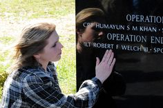 Becky Welch, widow of 1st Lt. Robert F. Welch, takes a moment to remember at the Memorial Dedication and Fallen Hero Ceremony. The day's events culminated in the dedication of a memorial for all the 3rd Brigade Combat Team, 1st Infantry Division Soldiers who have died since 2001 in the Global War on Terror. 1st Lt. Welch died last year from wounds suffered in a rocket attack at Forward Operating Base Salerno, Afghanistan.