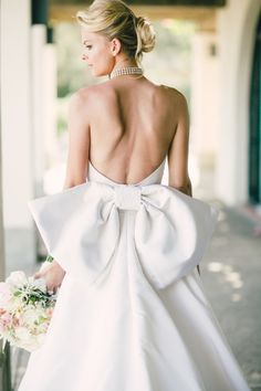 Gorgeous open back wedding dress with a bow: http://www.stylemepretty.com/collection/2322/