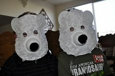 The most difficult part about making our polar bear masks was making the holes in the paper plate for the eyes. I traced a small circle for the eyes and then used a craft knife to cut them out. I've seen those Martha Stewart circle punches that would work perfectly for this but I didn't have one so I improvised.        For the snout we used one of those empty Dole fruit cups. I also used it to make the ears by tracing it onto a piece of white card stock paper, cutting it out and then cutting...