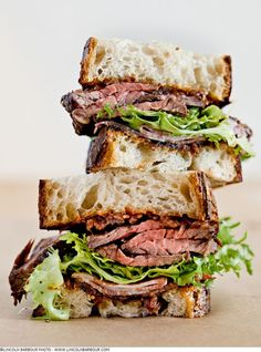grilled hanger steak & applewood smoked shoulder bacon sandwich with frisee & red onion jam (lincoln barbour))