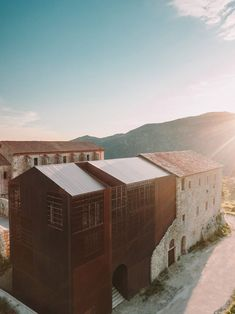 Amelia Tavella Architectes looked to preserve the history and essence of the convent by adding a perforated copper extension that adjoined its ruined walls.