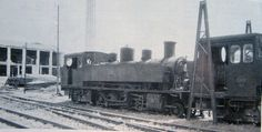 Locomotora del ferrocarril ferrol-Gijon 1 y 7 en Arnedo en 1965 frente a la chimenea de la central térmica. (Foto ferran Llauradó)