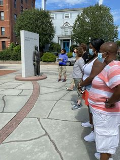 A group walking the Black History trail in Portsmouth, New Hampshire. They are currently at the African Burying Ground Memorial Park in downtown Portsmouth and view a sculpture by Jerome Meadow. #blackhistory #newhampshire...