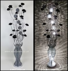 http://www.wirelamps.co.uk/WLF3174-8.html  158cm tall woven wire floor lamp in Silver and Black, black bloomed flowers and spherical illuminating shades.