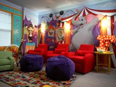 Decorating Ideas for Fun Playrooms and Kids' Bedrooms : The variety of seating options can be used when the family is having movie night or if the parents are watching the kids put on a performance. See previous slide to catch a glimpse of the stage.  From DIYnetwork.com