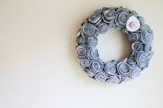 Grey Felt Rosette Handmade Wreath-credit-embellishedliving - this is pretty  I could also see some deeper ombre tones along with the lighter ones making a neat wreath.