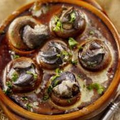 Escargot Stuffed Mushrooms Recipe Appetizers with softened butter, shallots, garlic, chopped celery, finely chopped fresh parsley, salt, ground black pepper, mushrooms, canned snails