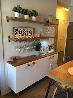 diy bar, statement bar, lage bar kitchen, wine glass rack, wood and gold, gold kitchen, pineapple decor, gold, long narrow table, diy dining table, kitchen decor ideas, interior design, encore designs, floating shelf, ikea hack, ikea ekby, diy floating shelves, rough pine, barnboard, ghost chairs, mid-century dining table, rustic table, grey stain table, small kitchen ideas, small kitchen narrow table, narrow table, long table, wood table