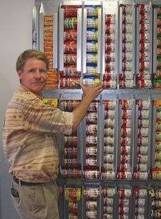 Wall system for canned food. How Sweet, I can imagine these, arranged to pull straight out, Like, Beside the Refrigerator and wall. No wasted Space! We all use the same Things. You could buy in bulk.
