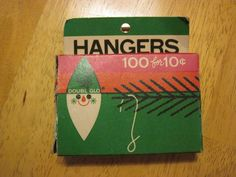 Vintage 1966 box of Doubl-Glo ornament hangers. There are 57 hangers.
