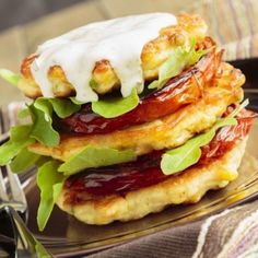 Corn fritters stacked with roasted tomatoes and arugula, served with ranch dressing Poblano, Corn Fritters, Roasted Tomatoes, Ranch Dressing, Arugula, Fries, Side Dishes, Sandwiches, Food And Drink