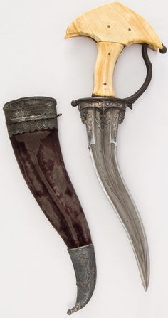 Indian khanjarli, 17th to 18th century, steel, ivory, velvet, silver, wood, H. with sheath 14 11/16 in. (37.3 cm); H. without sheath 13 1/8 in. (33.3 cm); W. 4 5/8 in. (11.7 cm); Wt. 13 oz. (368.5 g); Wt. of sheath 3.4 oz. (96.4 g), Met Museum, Bequest of George C. Stone, 1935.