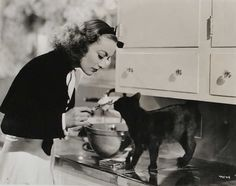 Joan Crawford,  no wire hangers...but eating what the kitty has eaten...I guess this could be cooking her way..ew