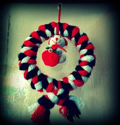 DIY #wreath. Had an old tricolor muffler, plated it like we would to our hair and just wrapped it around a circular frame.Add whatever little add ons u may have,I tied a small soft toy.