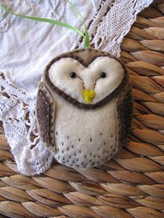 Felt Barn Owl Ornament is about 3 1/2 tall and a little over 2 1/2 wide. Comes with an attatched green ribbon for hanging which is about 4 long.