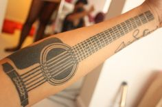 Guitar arm tattoo