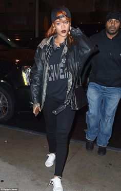 Tomboy chic: The 27-year-old was covered up in a dark casual outfit for the solo outing...