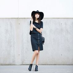 These 5 #OOTDs Will Make You Buy An Oversized Hat, Stat #refinery29  http://www.refinery29.com/oversized-hats#slide3  Blogger Ania Boniecka tops off her monochrome look with an oversized, cowboy-esque fedora.