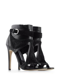 Camilla Skovgaard - My inner bad girl loves these! All I can think of are chains and leather.