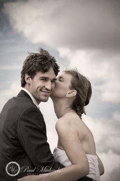 Groom get a kiss from his bride. Wedding photographer, Wellington, New Zealand. http://www.paulmichaels.co.nz