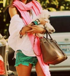 Off-the-shoulder baggy sweater, pink scarf, and green shorts