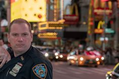 Policeman in New York - NEW YORK, USA - MAY 25 2018 -  NYPD policeman in Times Square is a major commercial intersection, tourist destination, entertainment center and neighborhood in the Midtown Manhattan
