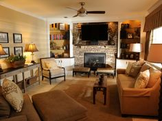 This transitional living room features a neutral color palette with shades of brown furniture. Two indented shelves surround a stone fireplace section making a lovely accent wall. A thin wooden coffee table sits in front of the sofa leaving free floor space.