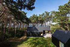 In a glade, three volumes form the iconic silhouettes of pitched roof houses in a staggered composition disposed with regards to site orientation, beach prot...