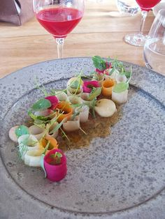 Pickled vegetables, each pickled in a different vinegar (eg. red beetroot is pickled in rosehip vinegar, yellow beetroot is pickled in elderflower vinegar, ), poached bone marrow with a sauce made from pork bones and brown butter, garnished with wild herbs including baby nasturtium leaves.